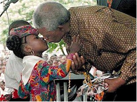 Mandela greets a young fan on visit to St Lucia