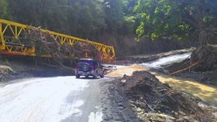 Freak storm devastates saint lucia dominica and st vincent on severed bridge at piaye sciox Images