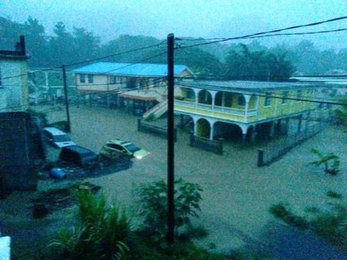 Flood hit homes in Roseau. Photo credit: Covert Intelligence LLC